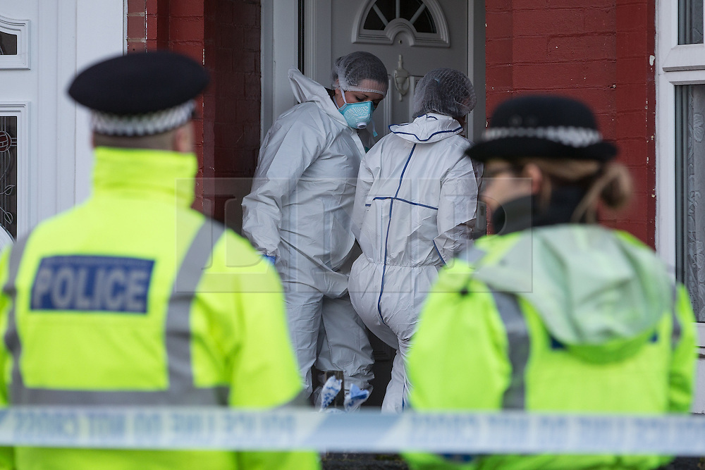 © Licensed to London News Pictures . 22/11/2013 . Manchester , UK . Police and forensic scenes of crime investigators on the scene at 18 Mayford Road , Levenshulme , where the body of a 49 year old mother of four , Aisha Alam , was discovered stabbed to death today (Friday 22nd November 2013) after a man , understood to be Aisha's husband , walked in to Longsight Police Station to report she had been killed . Photo credit : Joel Goodman/LNP