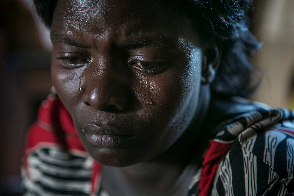 Margaret sheds tears as she talked about her life in the bush with LRA. She was abducted at the age of 11 in Acholi-bur village and was assigned to a commander two years later who had 13 wives. She also started a military training at that time and spent eight years as a soldier. She stayed in the bush for 8 years.