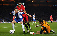 Photo: Paul Thomas.<br /> Espanyol v Sevilla. UEFA Cup Final. 16/05/2007.<br /> <br /> David Garcia (L) battles Daniel Alves of Sevilla as Espanyol keeper Gorka Iraizoz sides in.