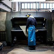 Santa Croce Sull'Arno, Italy. Alcyone tannery SPA. Pressing.