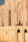 Man jumping into sea nearby Hassan II Mosque in Casablanca, Morocco