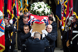 © Licensed to London News Pictures . 02/09/2013 . Bury , UK . Stephen Hunt's coffin is carried from the church after the service . The funeral of fireman Stephen Hunt at Bury Parish Church today (Tuesday 3rd September 2013) . Stephen Hunt died whilst tackling a blaze at Paul's Hair World in Manchester City Centre in July 2013 . Photo credit : Joel Goodman/LNP