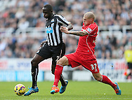 Moussa Sissoko of Newcastle United tussles with Martin Skrtel of Liverpool - Barclays Premier League - Newcastle Utd vs Liverpool - St James' Park Stadium - Newcastle Upon Tyne - England - 1st November 2014  - Picture Simon Bellis/Sportimage