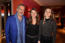 A party to celebrate the publication of renowned international fashion designer and icon Collette Dinnigan's book Obsessive Creative was held at the Ham Yard Hotel, One Ham Yard, London on 16th February 2015.<br /> Picture Shows:-Left to right, SIMON & LIZ BROWN and LOIS BROWN.