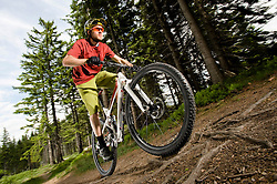 Man mountain biking, Saarland, Germany