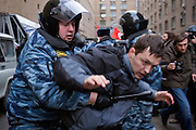 Moscow, Russia, 16/12/2006..Riot police arrest members of the National Bolshevik Party and other radical groups at the anti government March Of Dissenters. Several thousand opposition demonstrators gathered in central Moscow under the banner of the Other Russia movement led by Garry Kasparov. A planned march was banned, and the demonstrators held a meeting in a central square instead.