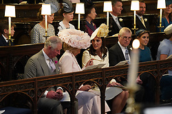 The Duchess of Cornwall (left) and the Duchess of Cambridge take their seats in St George's Chapel at Windsor Castle ahead of the wedding of Prince Harry and Meghan Markle.