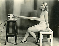 1927 A Hollywood Studio Club girl tries a weight shaking machine