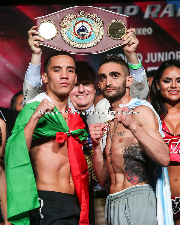Opponents Matias Rueda and Oscar Valdez, Jr. face off during the Featherweight WBO World Title weigh-in at the MGM Grand Garden Arena on July 22, 2016 in Las Vegas, Nevada.(Photo by Ringo Chiu/PHOTOFORMULA.com)<br /> <br /> Usage Notes: This content is intended for editorial use only. For other uses, additional clearances may be required.