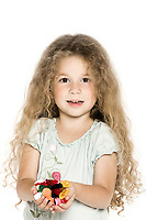 caucasian little girl handfuloffering candies cheerful isolated studio on white background