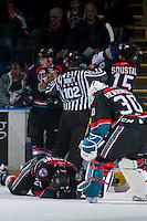 KELOWNA, CANADA - OCTOBER 26: Michael Herringer #30 checks on teammate Devante Stephens #21 of the Kelowna Rockets after an injury by the Victoria Royals on October 26, 2016 at Prospera Place in Kelowna, British Columbia, Canada.  (Photo by Marissa Baecker/Shoot the Breeze)  *** Local Caption ***