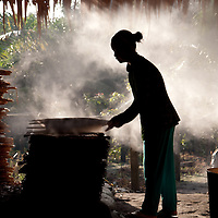 CAN THO, VIETNAM - AUGUST 27: a young lady working in a rice paper factory in Can Tho, August 27, 2010. Made from a batter of rice flour, water and salt. It is steamed, then dried on bamboo racks. Used as wrapper for spring rolls.