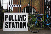 A bike rests against railings at St. Saviour's Church, Herne Hill SE24 that serves as a temporary Polling station for voters on Britain's general election day.