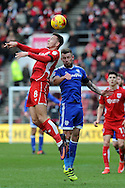 Bristol City's Josh Brownhill (l) beats Cardiff's Joe Ralls to a header. EFL Skybet championship match, Bristol City v Cardiff City at the Ashton Gate Stadium  in Bristol, Avon on Saturday 14th January 2017.<br /> pic by Carl Robertson, Andrew Orchard sports photography.