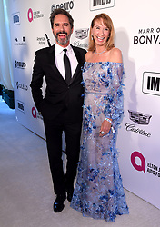 Eric McCormack and Janet Holden attending the Elton John AIDS Foundation Viewing Party held at West Hollywood Park, Los Angeles, California, USA.