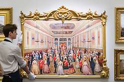 "© Licensed to London News Pictures. 16/11/2018. LONDON, UK. A technician presents ""St. Patrick's Hall, Dublin Castle"", by F.J. Davis (Est. GBP200,000-300,000). Preview of ""A Living Legacy"", the Irish Art Collection of Brian P. Burns, a collection spanning artists from the 18th century to the present day.  Over 100 works will be offered for sale on 21 November at Sotheby's in London.  Photo credit: Stephen Chung/LNP"