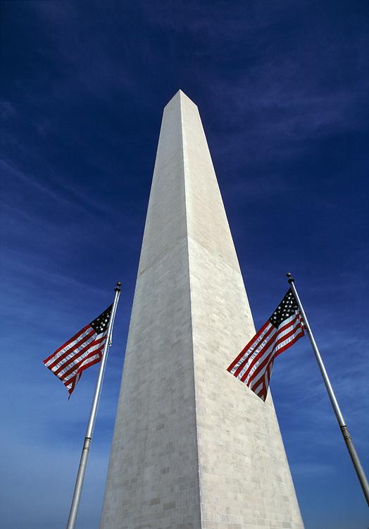 Waving American flags accent the stately Washington Monument, Washington, DC.
