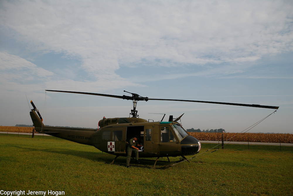 """A crew chief inspects a Vietnam era Huey restored by American Huey 369 before it flies during the 2008 Kokomo Indiana Vietnam Veterans Reunion. Accoring to the American Huey website, """"American Huey 369 Organization is formed for the specific purpose of preserving Huey Aircraft 369 (serial# 70-16369)"""""""