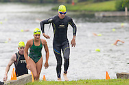 Monroe, New York - Racers leave the water after completing a 1/3-mile swim in the third annual Southern Orange Family YMCA Tri/Duathlon & Run/Walk on Aug. 2, 2014.