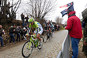 Belgium, March 31 2013: Peter Sagan, CANNONDALE PRO CYCLING, Fabian Cancellara, RADIOSHACK-LEOPARD, and an OMEGA PHARMA QUICKSTEP rider chase the race leader, Jurgen Roelandts, LOTTO BELISOL, on the final pass of the Oude-Kwaremont during the elite men's edition of the Ronde van Vlaandaren 2013 cycle race. Copyright 2013 Peter Horrell.