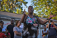 Veda Washington-Abusaleh, aunt of Alton Sterling, speaks at a vigil for Sterling on May 2, 2017  held in front of  the Trilple S Food Mart U.S. in Baton Rouge, Louisiana the day news leaked that the Justice Department  will not prosecute thee police officer who shot and killed Sterling last summer. Sterling's family is angry that tehy weren't conatected before the news broke.