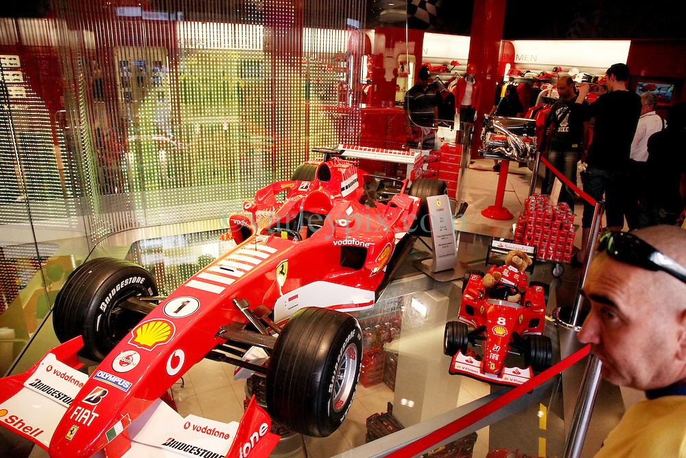 22 April 2011. London, England..The Ferrari store on London's Regent Street in the heart of London's West End. One of the 2005 Formula One cars sits in the middle of the floor attracting tourists..Photo; Charlie Varley.