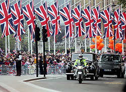 29 April 2011. London, England..Royal wedding day. Heavy police presence surrounds  Westminster Abbey as Prince Charles arrives with Lady Camilla..Photo; Charlie Varley.