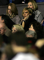 Photo: Paul Thomas.<br /> Manchester United v Europe XI. Friendly match. 13/03/2007.<br /> <br /> Victoria Beckham sits in the crowd before kick-off.
