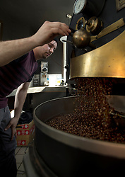 Co-owner and chief roaster Stevie Pape releases a batch of Ethiopian coffee beans from the roaster into the cooling tray, at Devout Coffee, Tuesday, April 5, 2016, in Fremont, Calif. (Photo by D. Ross Cameron)