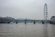 A view of Westminster bridge from the river Thames on a grey winters day. Westminster, London.  Built in 1862 it connects Westminster to Lambeth.