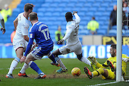 Cardiff City's Aron Gunnarsson (17) tries to scramble the ball in whilst  challenged by Aston Villa's Nathan Baker (l) Albert Adomah (37). EFL Skybet championship match, Cardiff city v Aston Villa at the Cardiff City Stadium in Cardiff, South Wales on Monday 2nd January 2017.<br /> pic by Carl Robertson, Andrew Orchard sports photography.