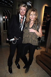 NICKY CLARKE and KELLY HOPPEN at a party to celebrate the launch of Hollywood Domino - a brand new board game, held at Mosimann's 11b West Halkin Street, London on 7th November 2008.  The evening was in aid of Charlize Theron's Africa Outreach Project.