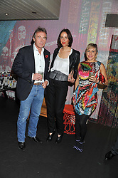 Left to right, TIM SPICE, VANESSA ARELLE and MAIA NORMAN at a Mexican Feast cooked by Thomasina Miers in aid of the charity Too Many Women held at Wahaca Soho, 80 Wardour Street, London on 9th November 2011.