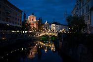 Night descends on the city of Ljubljana, Slovenia. Seen here are the Ljubljanica River, Triple Bridge, the Franciscan Church of the Annunciation, and Prešeren Square. (October 20, 2013)