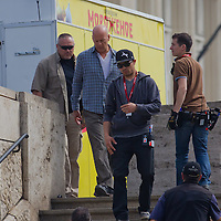 US actor Bruce Willis (3rd L) is seen among members of the cast as he leaves the scene after a shooting day of the fifth piece in the Die Hard series titled Good Day to Die Hard during a shooting day in Budapest, Hungary on May 19, 2012. ATTILA VOLGYI