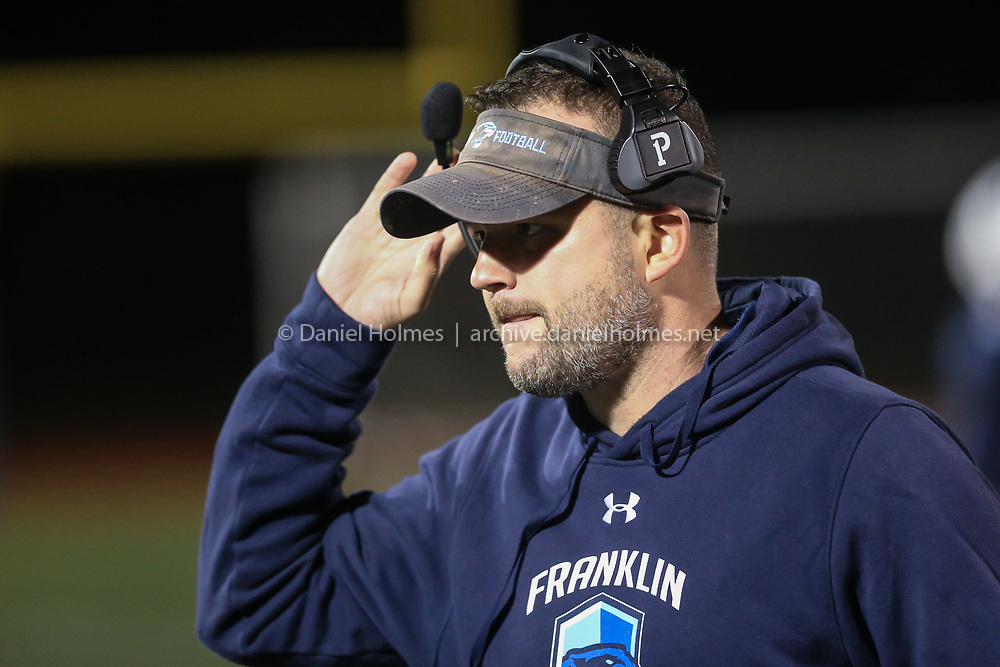 (11/1/19, FRANKLIN, MA) Franklin High football coach Eian Bain walks the sideline during the quarterfinals of the Division 1 South playoffs against Attleboro at Franklin High School in Franklin on Friday. [Daily News and Wicked Local Photo/Dan Holmes]