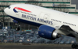 Undated file photo of a British Airways Boeing 777 taking off. British Airways owner IAG has reported a surge in profits, despite taking a hit from a major IT failure that caused travel chaos for tens of thousands of passengers in May.