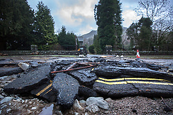 © Licensed to London News Pictures. 08/12/2015. Glen ridding UK. Picture shows broken tarmac on the way into Glenridding. The village of Glenridding has been cut of from the outside world for four days with no water, electricity or telephone lines after huge torrents of water from the surrounding mountains destroyed roads leading to it & flooded the village centre. Photo credit: Andrew McCaren/LNP