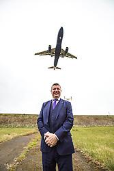 Matt shadowing Edinburgh Airport's chief exec Gordon Dewar as he runs Scotland's busiest airport. Pic at the end of the runway.