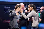 Ronda Rousey and Amanda Nunes face off during the UFC 205 weigh-ins at Madison Square Garden in New York, New York on November 11, 2016. Roused and Nunes will be fighting at UFC 207 in Las Vegas.  (Cooper Neill for The Players Tribune)