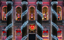 Edinburgh, Scotland, UK. 19 December 2020.  Views of streets and shops in Edinburgh City Centre on evening that Scottish Government announced the highest level 4 lockdown will be enforced from Boxing Day in Scotland.  Pic; Christmas decorations and lights on The Dome restaurant. Iain Masterton/Alamy Live News