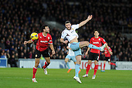 West Ham's Andy Carroll © is challenged by Steven Caulker of Cardiff city. Barclays Premier league, Cardiff city v West Ham Utd match at the Cardiff city Stadium in Cardiff, South Wales on Saturday 11th Jan 2014.<br /> pic by Andrew Orchard, Andrew Orchard sports photography.