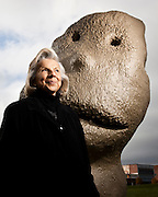 """Mary Pappajohn, with sculpture from the """"Moonrise East"""" series by Ugo Rondinone.  Shot in the John and Mary Pappajohn Sculpture Park, Des Moines, IA for Apollo Magazine.  2009-10"""
