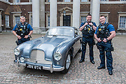 The armed police escort. An Aston Martin DB 2/4, which is understood to have been Ian Fleming's inspiration for James Bond's Aston Martin in the original novel Goldfinger. It was recently discovered and refurbished by owners  John and Daniel Walford.  It is to be auctioned on 12 July at Blenheim Palace  by international auctioneers Coys. The Old Admiralty Building, Whitehall London