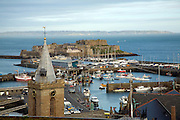 View over town and harbour to Castle Cornet with Sark beyond, St Peter Port, Guernsey, Channel Islands, UK