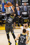 Golden State Warriors forward Draymond Green (23) dunks the ball against the New Orleans Pelicans at Oracle Arena during Game 2 of the Western Semifinals in Oakland, California, on May 1, 2018. (Stan Olszewski/Special to S.F. Examiner)