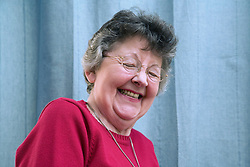 Portrait of an older woman laughing,
