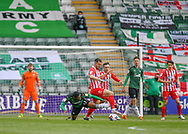 Plymouth Argyle forward Niall Ennis (21) battles for the ball midfield with Sunderland player  during the EFL Sky Bet League 1 match between Plymouth Argyle and Sunderland at Home Park, Plymouth, England on 1 May 2021.