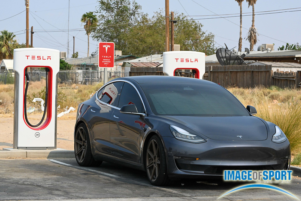 A Tesla Model 3 is seen charging at a Super Charger at EddieWorld, Monday, Sept. 14, 2020, in Yermo, Calif. (Dylan Stewart/Image of Sport)