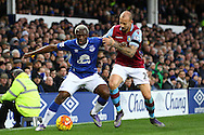 Arouna Kone of Everton holds off Alan Hutton of Aston Villa. Barclays Premier League match, Everton v Aston Villa at Goodison Park in Liverpool on Saturday 21st November 2015.<br /> pic by Chris Stading, Andrew Orchard sports photography.